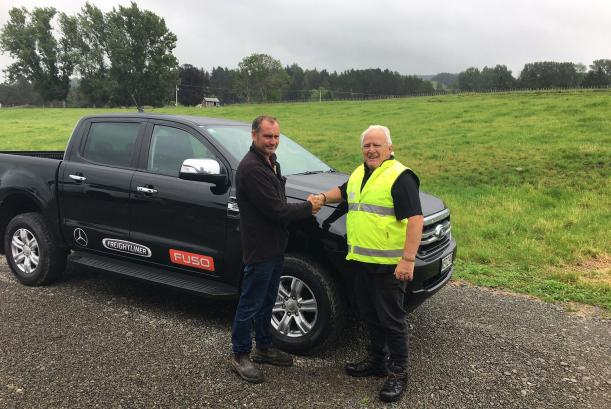 Hamish Cavanagh of HWCT Ltd, who bought a Freightliner Century Class CST112, receives his Ranger from driver trainer Herb Dalton